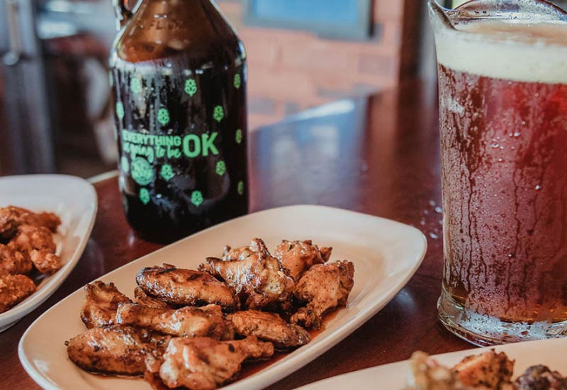 Growler, Pitcher, and plates of wings